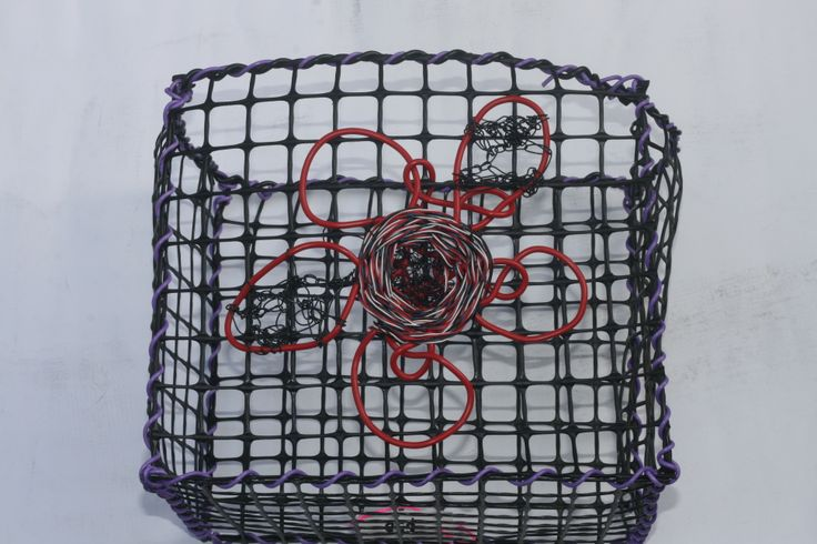 © Maritza Noa-Cabrera.   Pink flower, vintage inspired basket. Plastic and telephone cable wire.