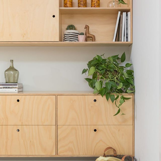 Hoop pine plywood buffet unit features notch out handle detail, in line grain and a sliding overhead door to hide a wall mounted tv. #hooppineplywood #midcenturystyle #kitcheninspo #kitchendesign #kitchendetails