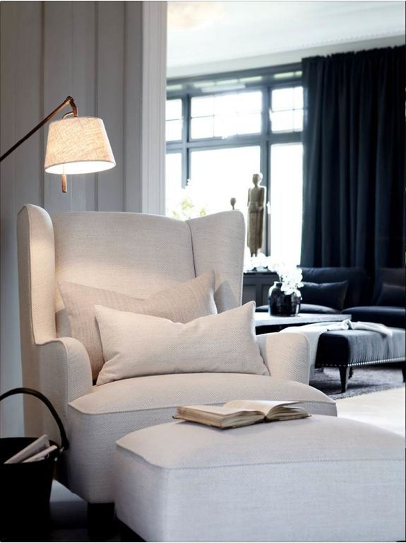 Love the chair color and fabric, dark navy drapes, elegant and soothing color scheme.