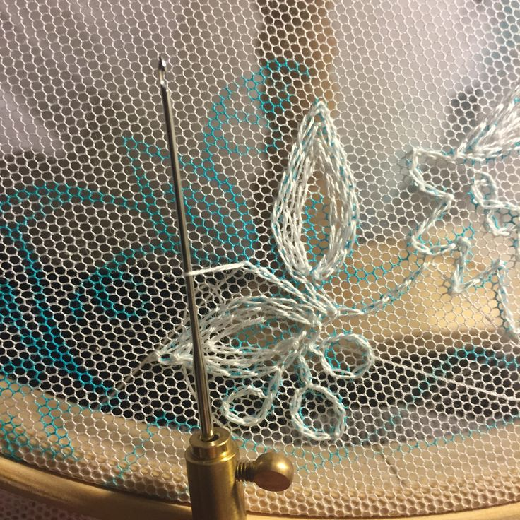 Making a tambour lace veil.