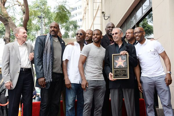 Chris Paul Photos - Present and former Los Angeles Clippers players including, Lamond Murray, Gary Grant, Chris Paul, Sam Cassell, Olden Polynice, Norm Nixon, Cuttino Mobley, and coach Doc Rivers, pose for a photo as sportscaster Ralph Lawler is honored with a Star on the Hollywood Walk of Fame on March 3, 2016 in Hollywood, California. - Ralph Lawler Honored With Star on the Hollywood Walk of Fame