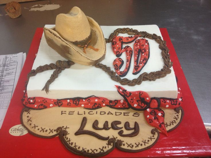 Cowgirl themed cake with 3-d cowboy hat, and bandana and rope to finish off decorations