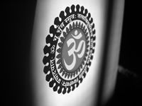 Om symbol in black and white