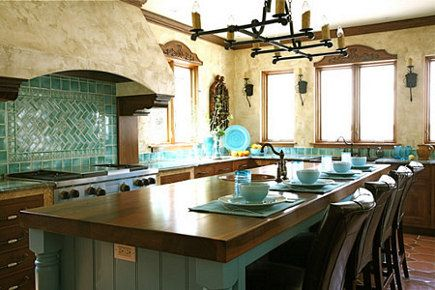 Mexican California Mission kitchen.  Rustic and welcoming with turquoise and warm reddish browns.