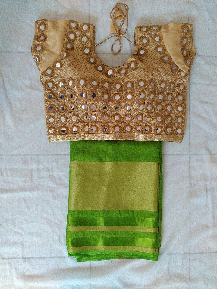 Pretty mirror work done saree blouse design. Love the green silk saree and golden blouse combo. Indian fashion.