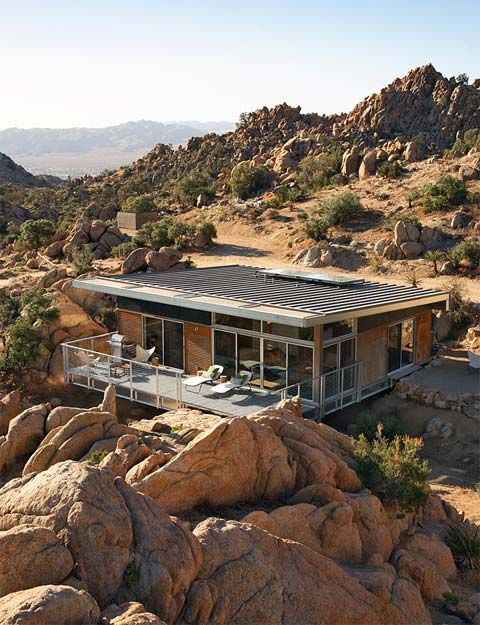 The Bluesky Home in Yucca Valley, California, is a beautiful, modern prefab. Nestled among impressive rock formations, this small, prefabricated house blends perfectly with its desert surroundings, ensuring minimal site disruption while maximizing views and retaining privacy. On top of that, it's also adaptable, sustainable, modestly scaled, durable and economical.