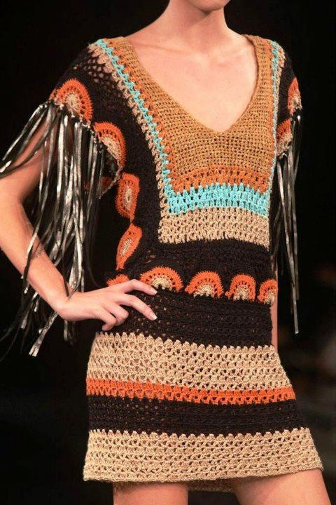 .I like the over-all pattern.  Maybe minus the circles and tone down the fringe?