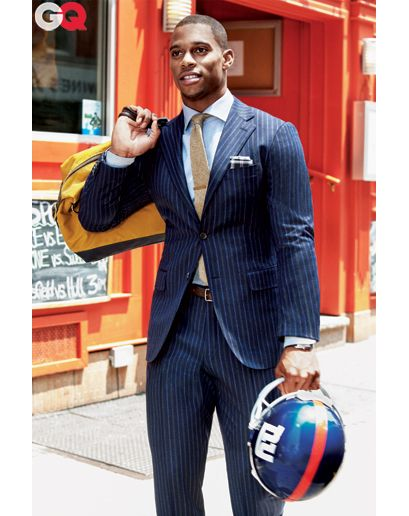 Now Let's Go to Work  Don't get us wrong, you can still wear pinstripes as a business suit. But how do you make it look fresh in 2012? With a spread-collar dress shirt, a skinny-ish tie, and if you're Victor Cruz, your helmet.