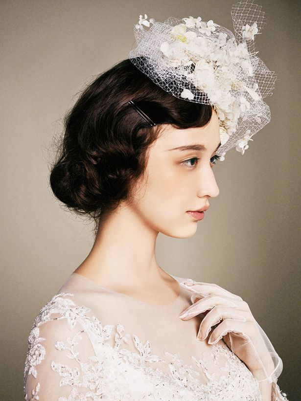 [This photo makes me think of old-time painted portraits.  I like how very individual she looks.  I'm surprised they didn't use more decorative bobby pins, though--there are plenty of styles out there.]