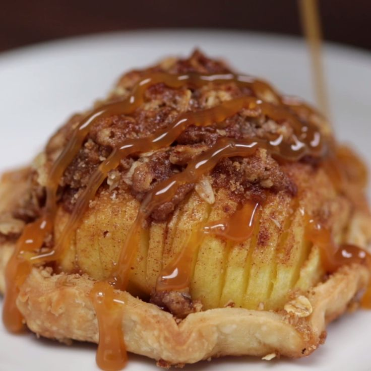 Warm sliced baked apple topped with a brown sugar cinnamon crumble, hugged by a crispy baked pastry. Add a scoop of ice cream and this is the perfect fall treat!