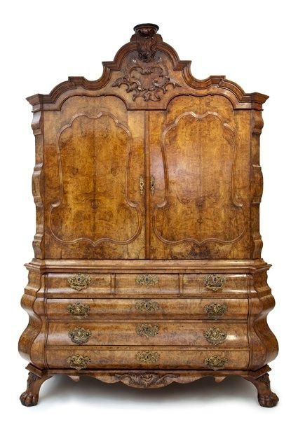 A Louis Quinze walnut cabinet with open knees with secret drawers