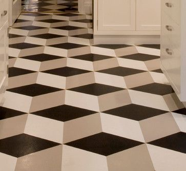 this artistic flooring is a solid color in a black gray and white geometric pattern - Tile Floor Patterns