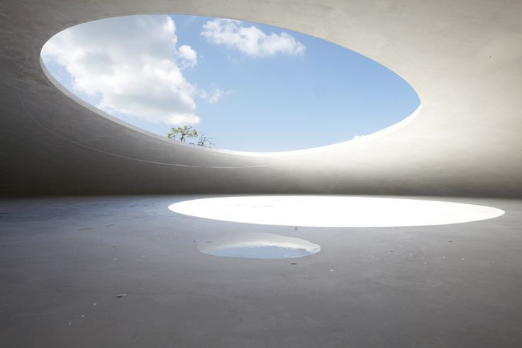 "RYUE NISHIZAWA & REI NAITO, TESHIMA ART MUSEUM: ""at 25 cm thick, the white concrete pod shell is devoid of any pillars or visible structural aid."""