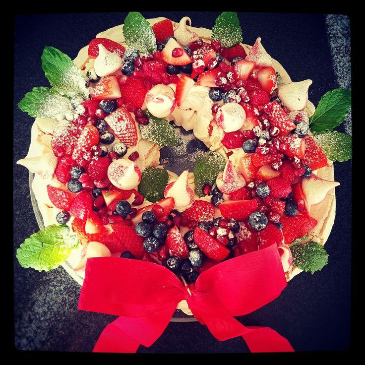 Christmas pavlova wreath #pavolva # wreath #vanillacream #strawberries #raspberries #blueberries #pomegranate #mint #meringuekisses