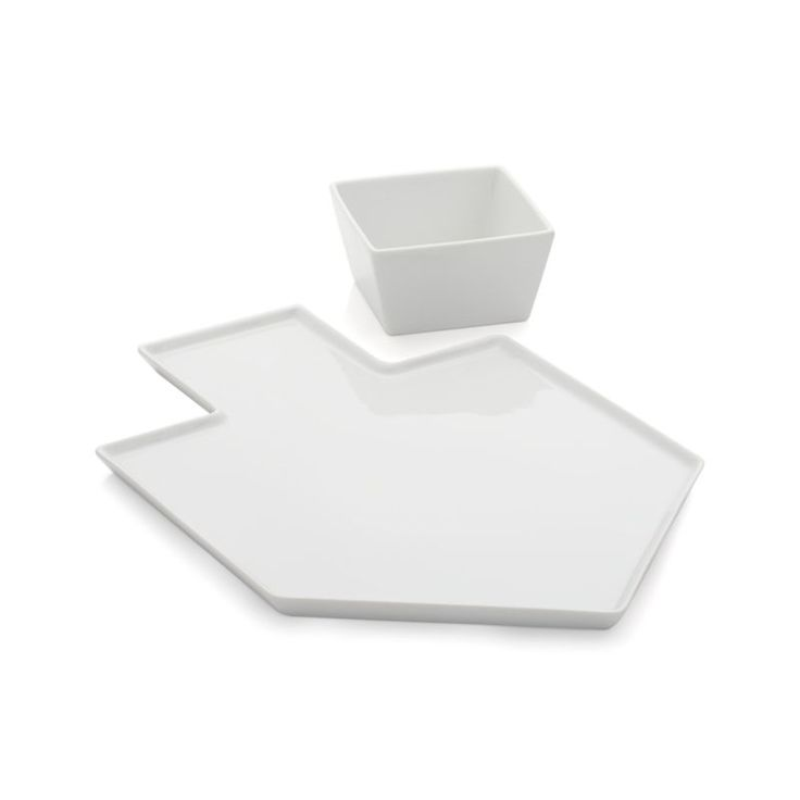 Ingenious design translates the dreidel shape into a two-dimensional, streamlined platter, with room on its handle to tuck a square dip bowl.  Generously sized platter accommodates heaping servings of latkes and other Hanukkah treats. PorcelainDishwasher-, microwave- and oven-safe up to 350 degreesFood safeMade in China.