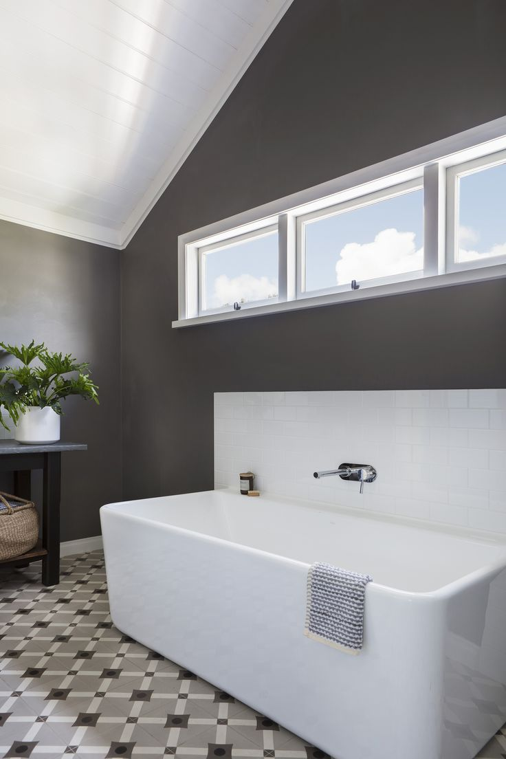 The Caroma Cube back-to-wall bath is both functional and stylish in this family friendly bathroom styled by interior designer Jo Carmichael, of Texture Tone Design. Photography: Bo Wong | Stylist: Jo Carmichael | Story: Australian House & Garden