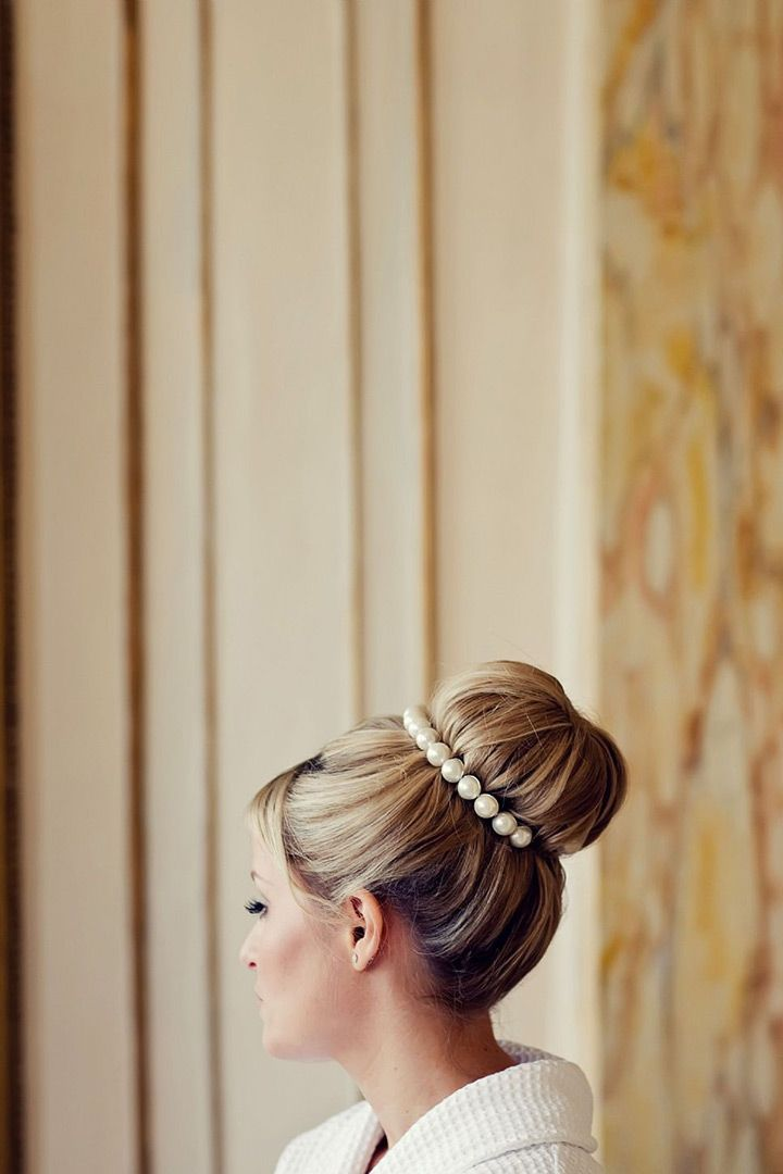 love this high bridal bun wrapped in pearls - sooo pretty!  ~  we ❤ this! moncheribridals.com