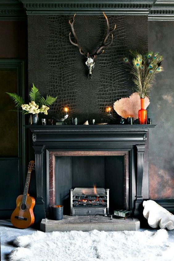 This textured room screams masculinity with crocodile wallpaper and a black mantle. Love it!