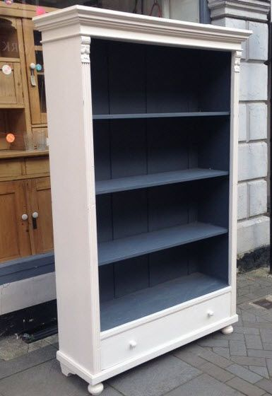 White bookcase, with painted back. I like this, but wouldn't have painted the sides of the shelves, just the back.