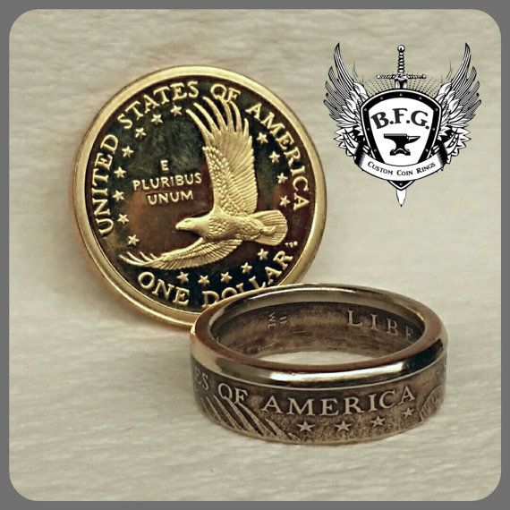 SACAGAWEA DOLLAR COIN RING (1)  SIZES: 7 - 10  (Copper/Nickel / Manganese Alloy) PLEASE READ THE FULL LISTING BELOW ! This may help with questions you may have..   OPTIONS Only year 2003 Available Sizes: 7, 7.25, 7.5, 7.75, 8, 8.25, 8.5, 8.75, 9, 9.25, 9.5, 9.75, 10 Which Side Exposed? Picture Shows Tails out. You can choose Heads as well..  Except for your choice of RING SIZE, your ring will look similar to those pictured in both form and condition. I do not have pick your own date...