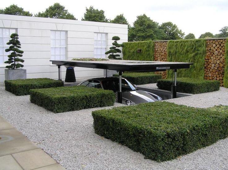 comment aménager son jardin avec des arbustes taillés, des plantes grimpantes et du gravier concassé