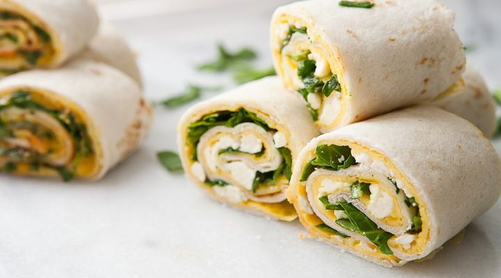 Breakfast Pinwheels rolled with a thin scrambled egg layer, cheese, and chopped spinach! Two easy variations are included!