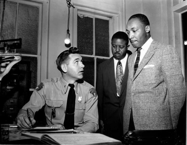 The Rev. Martin Luther King Jr., right, accompanied by Rev. Ralph D. Abernathy, center, is booked by city police Lt. D.H. Lackey in Montgomery, Ala., on Feb. 23, 1956. The civil rights leaders are arrested on indictments turned by the Grand Jury in the bus boycott. (AP Photo/Gene Herrick) Photo: GENE HERRICK, STF / Beaumont