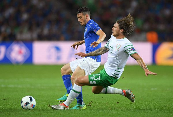 Alessandro Florenzi of Italy is tackled by Jeff Hendrick of Republic of Ireland during the UEFA EURO 2016 Group E match between Italy and Republic of Ireland at Stade Pierre-Mauroy on June 22, 2016 in Lille, France.