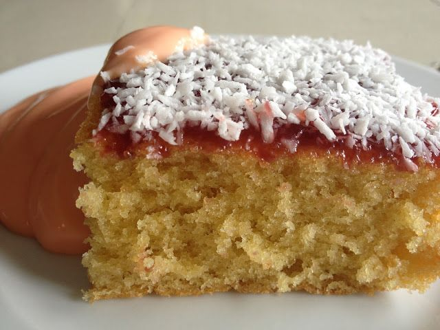 Jam and coconut sponge pudding with pink custard