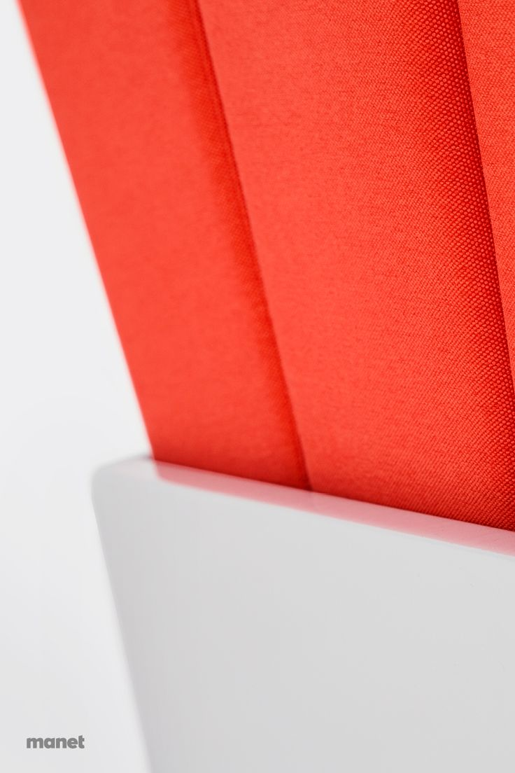 A detail of MANET Easy Chair: the nice contrast of colors and textures between the pillows linings and the vinyl fabric which covers the containing box.