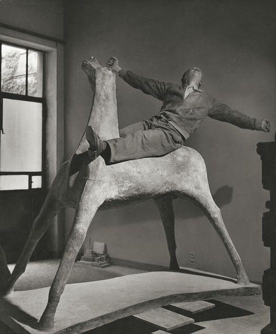 Marino Marini in his studio on one of his horses, Milan, 1952.