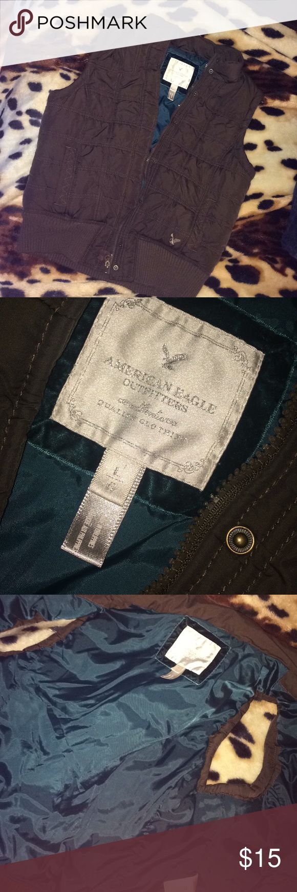 American eagle outfitters puffy vest Hood is missing other wise great condition, gently worn! Size large. Brown with teal blue inlay! American Eagle Outfitters Jackets & Coats Puffers