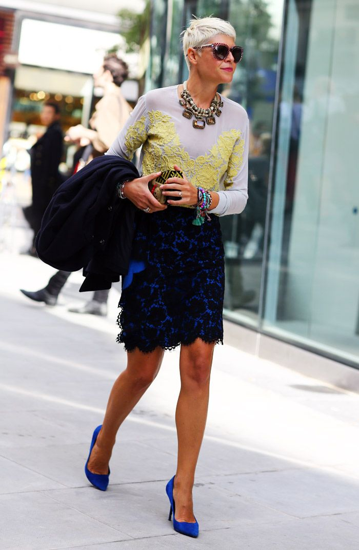 Elisa Nalin, London in a LANVIN necklace, lace embroidered top, lace skirt, and BURBERRY PRORSUM box clutch.
