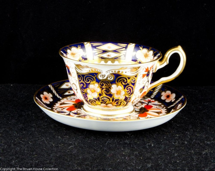 A gorgeous little duo of coffee cup and saucer in pattern 2451 with a gilded handle Derby 2451 is one of the iconic and most collected of the Royal Crown Derby patterns, dating from 1918