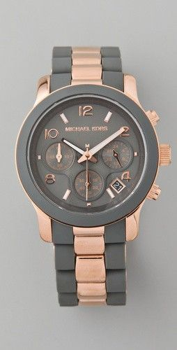 Pretty rose gold tone and black analog watvch by Michael Kors. I like that it's not too dainty -repinned