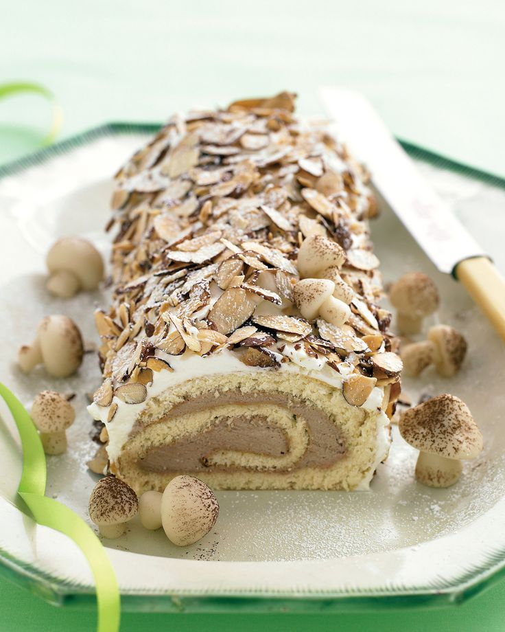 A simple version of the classic French dessert buche de Noel, this enchanting cake covered with crunchy almonds and creamy frosting calls to mind a snow-covered log in a wintry forest.