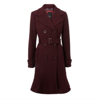 dark red flippy hem coat from Betty Jackson. Black. Encompassing a bold feminine colour, floaty feminine hemline for a dreamy look to the bottom and a tie waist, this is a classic designer masterpiece. Branded buttons finish the look with a final designer flair.  love that hemline!