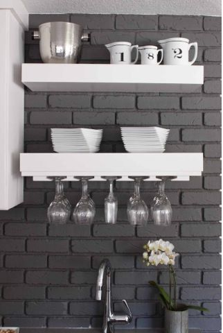 Painted brick on Living Room Side....Like the idea of a deep taupy grey