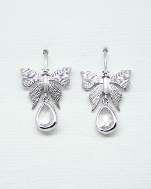 A very cute  pair of butterfly earrings with single tear drop crystal and crystal to the top.  Butterfly measures 18 x 14mm and is crafted in brass, matte rhodium plated to keep it's tarnish free resistance.  Crystal measures 11 x 7mm. The overall length of the earrings is 25mm from the top of the fitting.  The butterflies are fixed on rhodium plate hook fittings.  Butterfly earrings with crystal drops.  All of our jewellery comes in blue or silver box with ribbon bow.  #Crystal #Earrings...