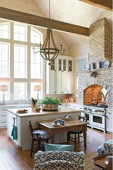 love the brick, the neutrals, and the adorable table and chairs backing up to the island