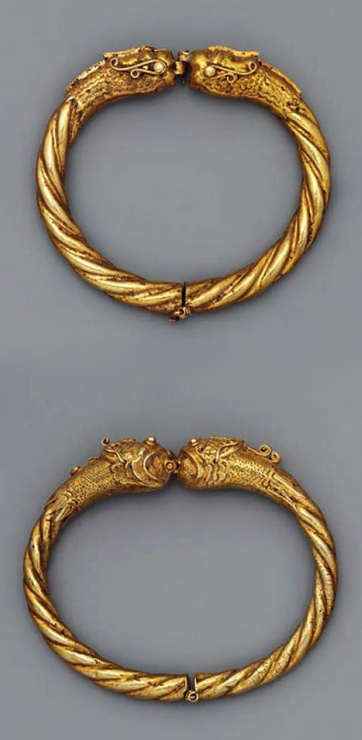"""These twisted bracelets (Gold, 19th century) from South Sumatra are embellished with 'naga' heads.  Naga bracelets and anklets tipped with lotus buds persisted long after the passing of Hindu-Buddhist beliefs"" 