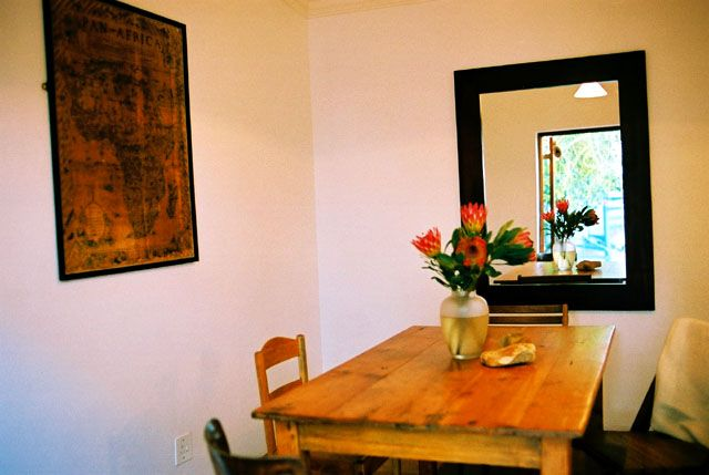 Self catering accommodation, St James, Cape Town  The Grapevine dinning room table   http://www.capepointroute.co.za/moreinfoAccommodation.php?aID=52