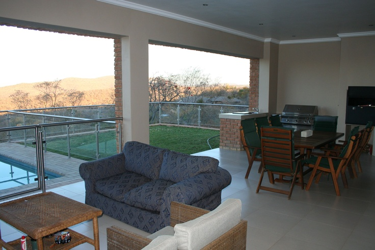 Huge undercover patio with built in barbeque and pizza oven, leading to garden and pool - and the view