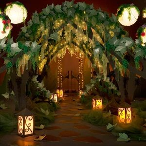 Tree Canopy Theme Kit from Andersons.com. But we could recreate this with twisted butcher paper, greenery, and lights.