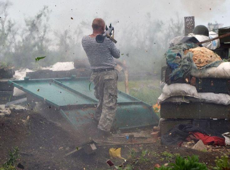 An Ukrainian serviceman fires a grenade launcher