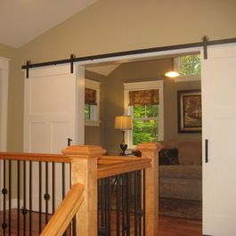 Barn Door Hardware | white paneled double doors with sliding barn door hardware | Bayer Built Woodworks