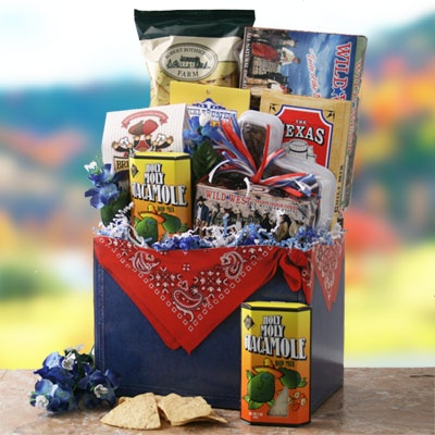 Texas Round Up  Texas Gift Basket    There's nothing more tempting than the savory tastes from Texas! This handsome Texas themed basket box is bustin at the seams with Texas chili mix, tortilla chips, holy moly guacamole dip mix, wild west peant brittle, Sucklebusters seasonings, Texas Alamo shortbread cookies, Texas shaped container filled with chewy pecan pralines, Brent & Sams cookies,