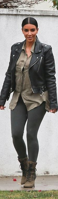 Kim Kardashian's black leather jacket and green ankle boots style id