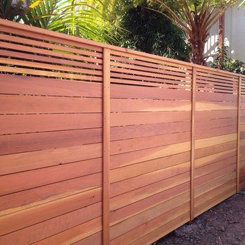 Custom horizontal fence with picket accent top.. Stained natural.. | Yelp