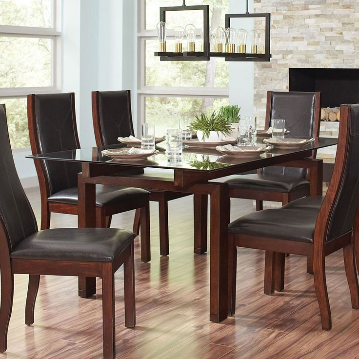 This transitional Rossine Dining Room Collection by Coaster Furniture can serve as everyday dining or formal in single dweller's home. The table base is crafted of solid poplar wood in a red brown finish. The table features strong beveled tempered glass top. Gather your family and friends around to enjoy your delicious home cooked meals with this stunning collection in your home.